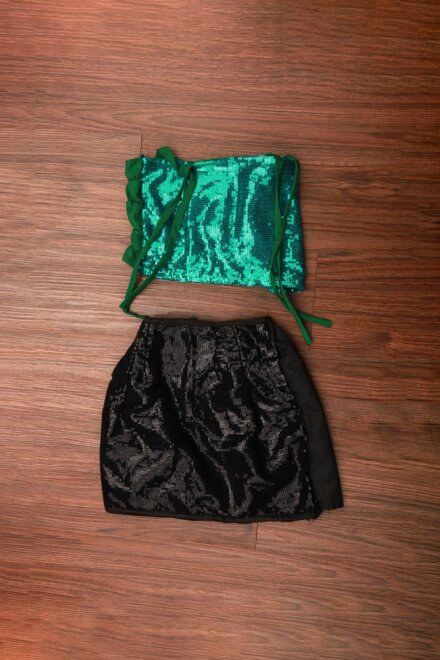 BLACK SKIRT AND GREEN TOP